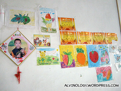 The walls of all the village houses were adorned by kids' drawing and certs
