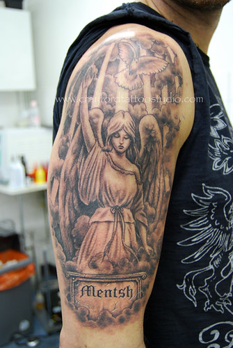 Angel and Dove Tattoo Tattooed by Ray