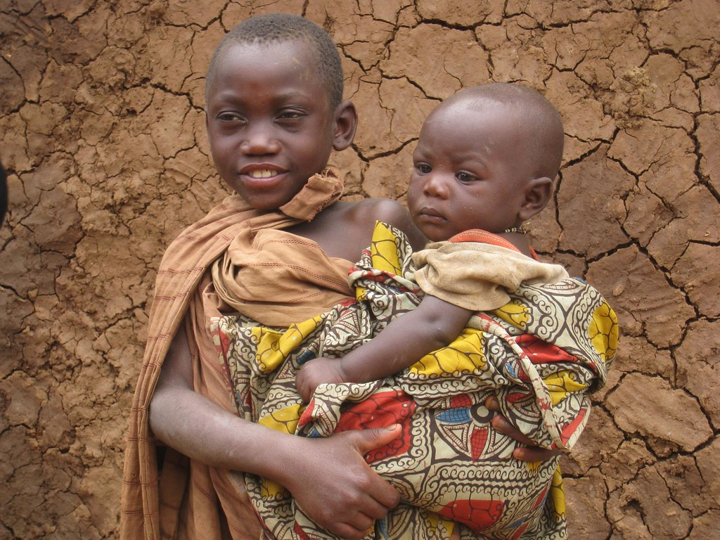 It is not uncommon for young children to be seen carrying babies.