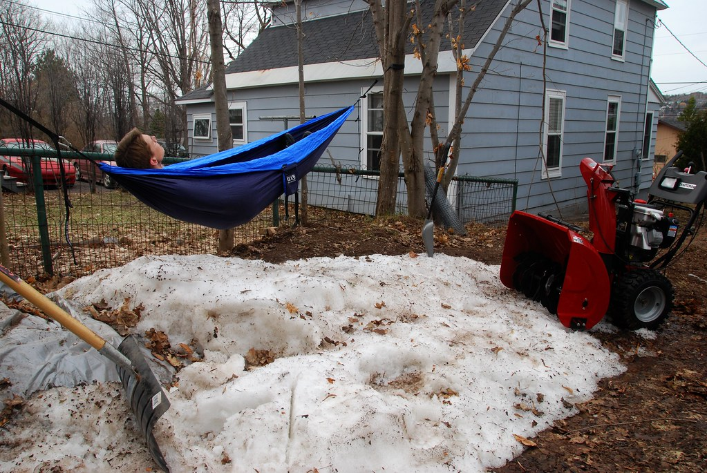 Me in a hammock, over a big pile of snow (and a snowblower)
