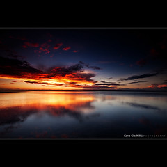 Best of both Worlds. ([ Kane ]) Tags: sunset sky orange sun beach wet water clouds reflections photography sand bravo colours purple dusk qld queensland bluehour kane reds cokin wellingtonpoint gledhill sigma1020 50d kanegledhill wwwhumanhabitscomau kanegledhillphotography