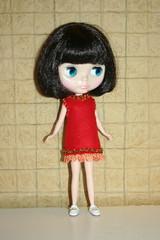 Joss, in a little felt dress I made