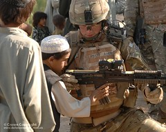Soldier With Afghan Child (Defence Images) Tags: afghanistan man male soldier army gun child unitedkingdom military optical equipment weapon afghan british op operation campaign defense a2 defence sights firearm afganistan personnel herrick afg assaultrifle helmand smallarms l85 susat nadeali nonidentifiable