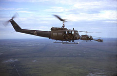 """""""Slicks"""" in the air over the Delta (Nigel Smuckatelli) Tags: chopper cambodia vietnam helicopters soc trang gunship vietnamwar uh1b 336thahc"""
