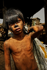 Children of Ulingan (Charcoal Factory), Manila - Filthy Me,  Pic #12 (Mio Cade) Tags: boy portrait sun white black hot hope kid asia ray factory child sad labor smoke philippines documentary environmental social burn human charcoal rights manila trust labour strength coal pathetic mechanism coping tondo sunlihgt ulingan