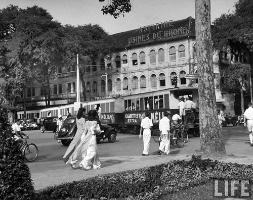 Saigon 1948 -  Locals riding the street car, in French Indochina.