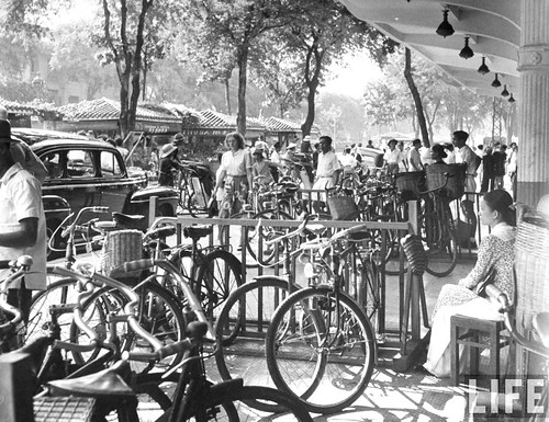 Saigon 1948 - In French Indo China, racks of bicycles lining the street.