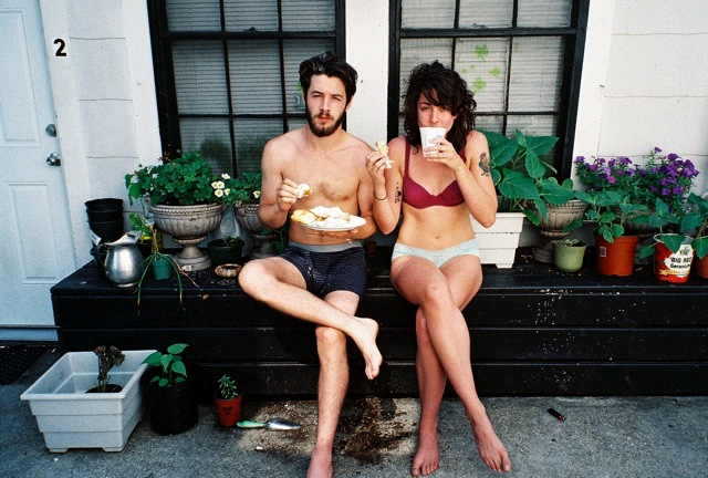 couple eating breakfast in their undies