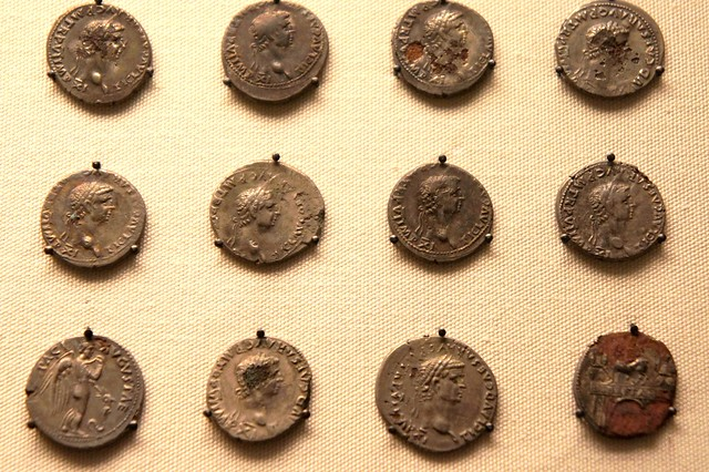 Suffolk forger's hoard of plated coins, detail of 12 coins various types of the emperor Claudius