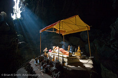 Reclining Buddha, Tham Phu Kham Cave, Vang Vieng (adventurocity) Tags: travel vacation tourism photography photo asia southeastasia photographer buddha buddhist picture buddhism visit tourist traveller adventure cave laos visitor vangvieng traveler indochina religiousicongrpbuddist thamphukham