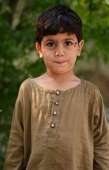 Kid Portrait (basitkhan7) Tags: kids kidsphotography child innocent pose nikon 50mm yongnuo 18g d5100 green yellow blue eyes