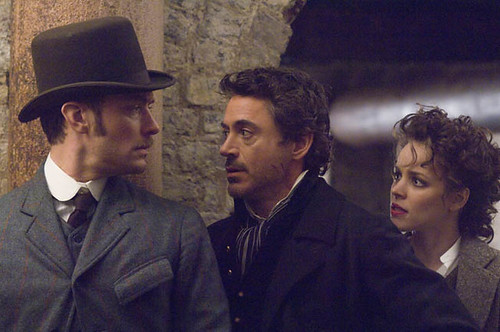 (L-R) Jude Law, Robert Downey Jr. and Rachel McAdams bring the slightest bit of joy to an otherwise lackluster 'Sherlock Holmes'.