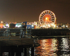 Santa Monica Pier is for lovers (floating_stump) Tags: santamonicapier california theocean ferriswheel carnival rides makingout lovers caught night nighttime lightsonthewater improvisedtripod powershots400