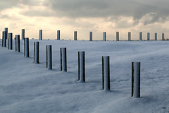 The Empty Car Park (Gay Biddlecombe) Tags: snow clouds sussex shadows posts carpark seaford
