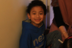 The whole picture's a bit blurred, but I love Naeiil's smile in this (idlan) Tags: makan colchester fch