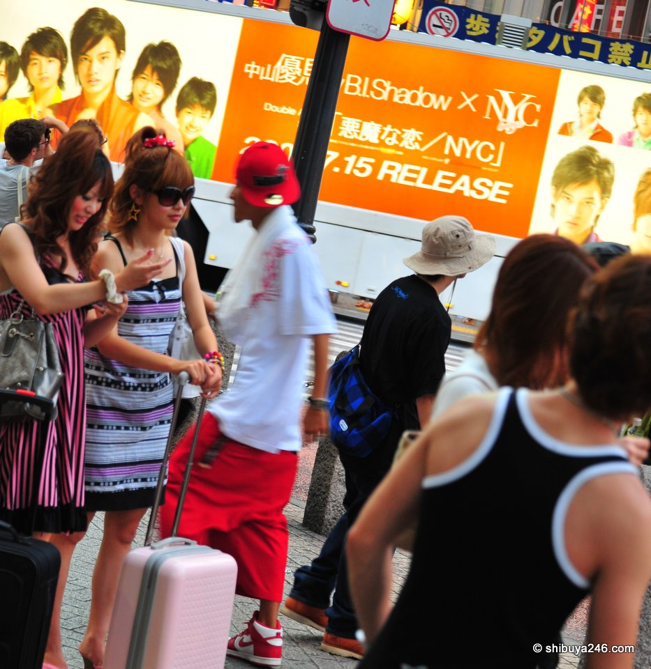 Fashion in the foreground, ads in the background. Lots of action in Shibuya