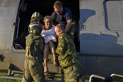 Canadian Soldiers Aid Elderly Haitian at Port-...