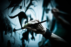 Drawing hands (ArTeTeTrA) Tags: blue painting hands dof bokeh drawing blu mani canvas stolen tela canonef50mmf14 cinquantino maxfrezzato wwwlenuvoledideandrecom frammentidacqua