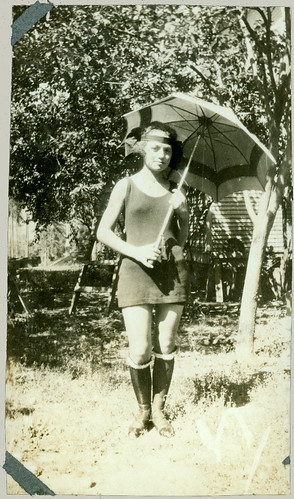 Parasol, swimsuit and boots