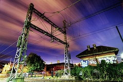 power overhead (mugley) Tags: pink blue roof sky tree green overgrown night clouds digital fence buildings graffiti nikon pieces d70 zoom suburban tracks ivy australia melbourne wideangle brunswick victoria motionblur wires electricity suburbs bluehour 12mm opuntia dslr pylons creepers f8 railwayline stanchion urbanlandscape priclypear upfieldbikepath tokina1224mmf4atxpro upfieldline tokinaaf1224mmf4 1213s gettyreject offwatsonst