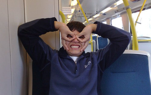 Isaac goofing around on the train