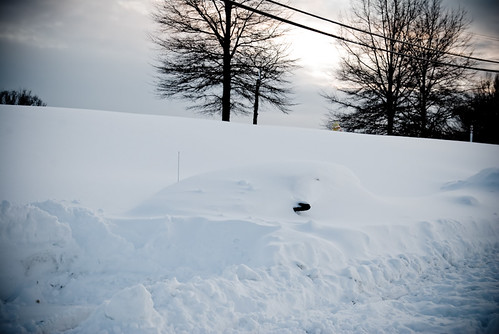 Car buried in 33 inches of snow