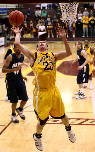 a college basketball player going in for a layup