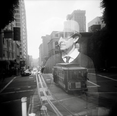 Seth in the City (diyosa) Tags: sanfrancisco bw film mediumformat seth holga doubleexposure cablecar neopan400 fujineopan film:iso=400 film:brand=fuji ilfordilfosol3 filmdev:recipe=5429 developer:brand=ilford developer:name=ilfordilfosol3 film:name=fujineopan400