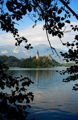 Lake Bled through the trees (Desmond Charles Photography) Tags: lake slovenia lakebled julianalps bledisland pilgrimagechurchoftheassumptionofmary