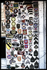 Pick-A-Patch (loltographer) Tags: nyc grit grunge gritty highkey patches grungy d300 bleachbypass militarypatches