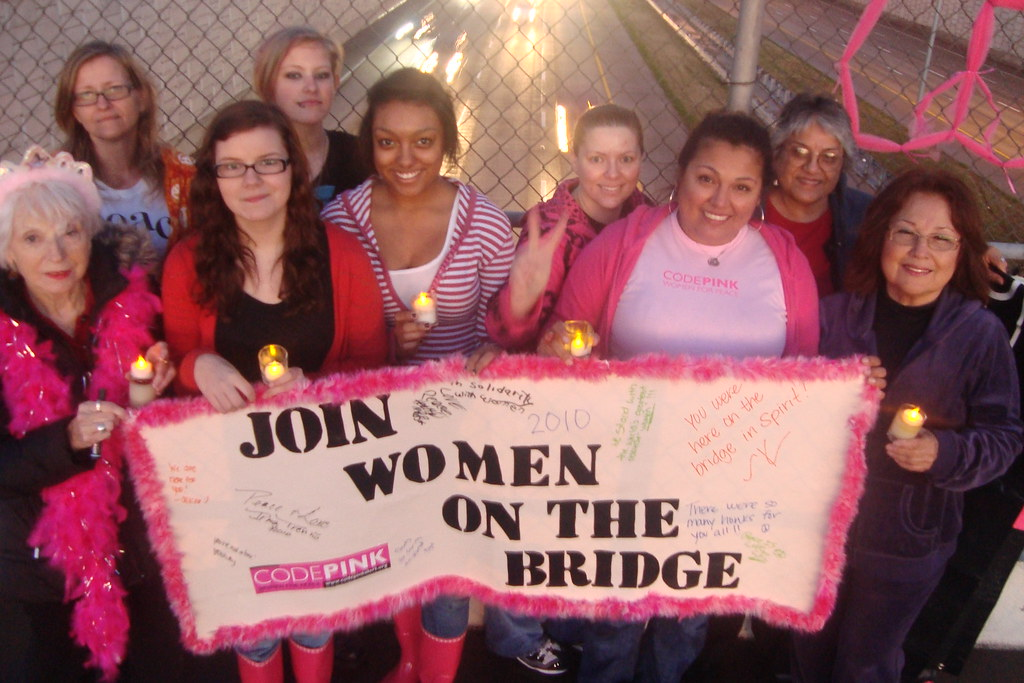 Women in Ft. Worth, Texas march for peace across an overpass bridge on International Womens Day, March 8, 2010