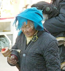 Praying with Blue Hat (Stanley Zimny (Thank You for 24 Million views)) Tags: china old blue woman hat wheel lady walk prayer religion praying buddhism tibet zen tibetan