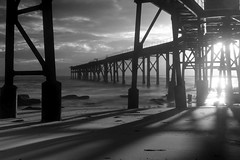 Shadows in B/W by request (pominoz) Tags: sea industry silhouette clouds dawn pier blackwhite industrial waves mining nsw catho catherinehillbay coalloader