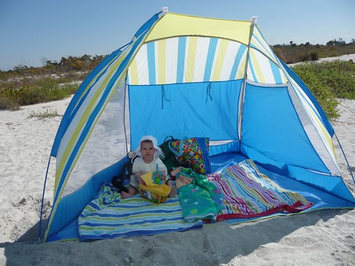 mila in beach tent in sanibel.