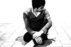 Judged (Ashoori) Tags: white man guy tile bahrain sad ground balck 2010 ejo yound judged eh3an alikarimi