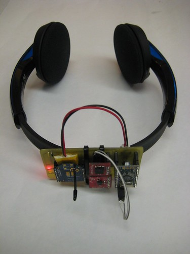 [Redefining 5.1's head tracking system mounted on Bluetooth–enabled headphones.]