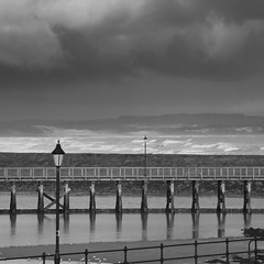 Amble pier (Ali's view) Tags: sea england seascape lamp landscape mono coast nikon surf cloudy northumberland northeast amble 18200mm d90