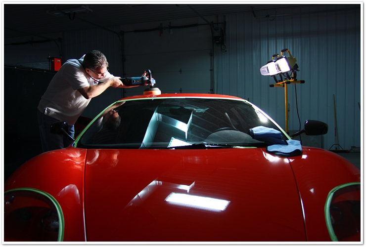 Todd Cooperider of Esoteric Detail buffing a Ferrari Challenge Stradale