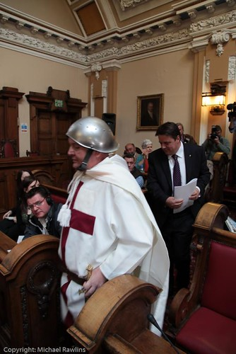 Nick Griffin enters the council chamber with 'St George'
