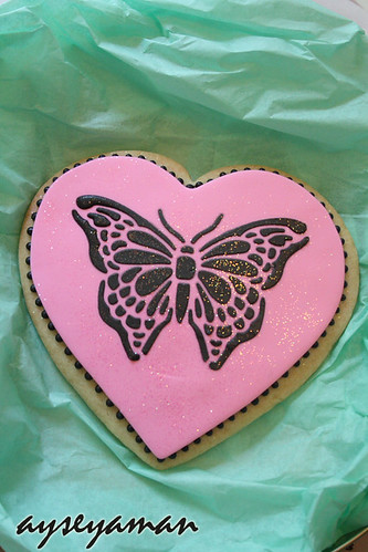 Royal icing butterfly cookie made by stencil technic