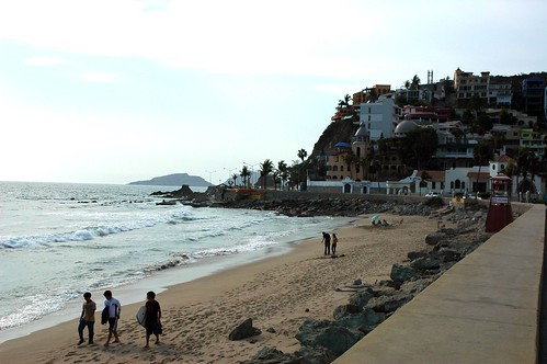 Strolling down the beach with surf boards, hanging out under an umbrella, South Mazatlan beach in the afternoon, beyond the seawall, Mexico by Wonderlane
