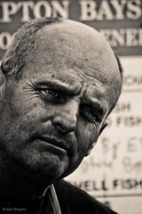 Another day, another one that didn't get away (alan shapiro photography) Tags: portrait monochrome sepia mono intense expressive characters wrinkles wandering fishmonger 2010 roaming pleasantvilleny anotherday laughlines alanshapiro locavore momentsoftruth ashapiro515 pleasantvillefarmersmarket 2010alanshapiro alanshapirophotography wwwalanwshapiroblogspotcom 2010alanshapirophotography
