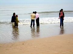 Indian bathing (Guillaume Millet) Tags: ocean travel sea people india beach swimming october asia indian bombay trousers bathing mumbai juhu refresh