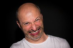 Italian trying to bite his tongue off (Adult Grimaces series) (Phototravelography) Tags: grimaces adultgrimace italy portrait closeup detail expression expressive fun funny man person