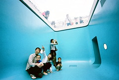 family pool (troutfactory) Tags: family blue art film water pool strange up japan fun weird artwork underwater looking voigtlander dream surreal rangefinder wideangle installation  analogue superia400 pointing 15mm bessal kanazawa drifting heliar belowthesurface  theswimmingpool leandroerlich 21 21stcenturymuseumofcontemporaryart