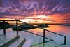 Colour Explosion (-yury-) Tags: ocean longexposure sun seascape colour beach pool sunrise canon landscape rocks explosion sydney australia nsw 5d curlcurl supershot leefilter abigfave
