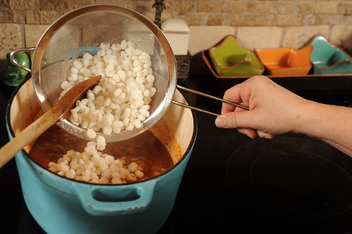 Adding hominy to posole