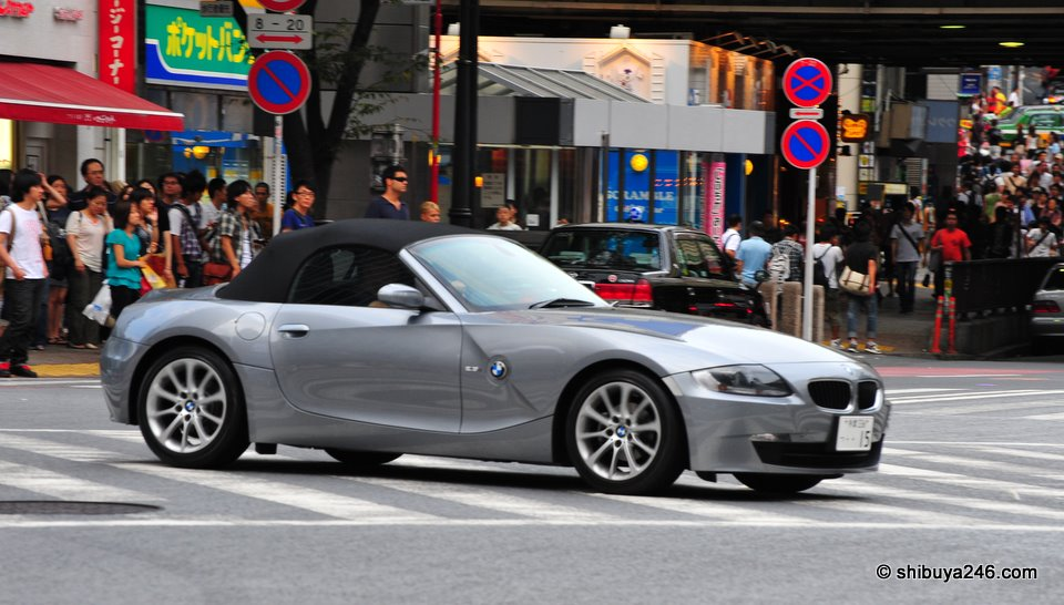 Nice sporty BMW convertible passing through town