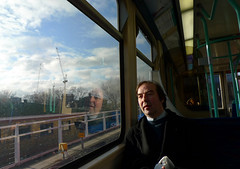 It is going to be not bad day after all.. (Che-burashka) Tags: man reflection london window weather smiling train candid greenwich dailycommute commute passenger deptford dlr lx3 insidethecarriage