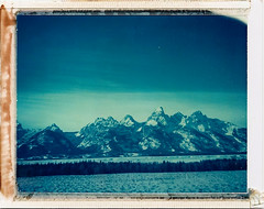 ID-UV tetons 1 (polaroidmandy) Tags: blue winter mountain snow mountains cold polaroid nationalpark jackson wyoming peaks tetons expired grandteton jacksonhole iduv supercolorpack